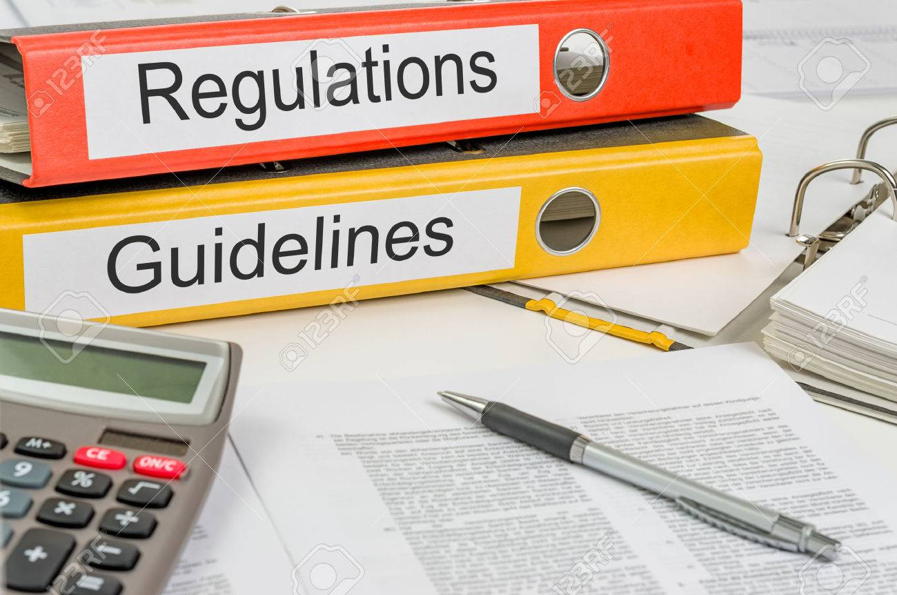 Folders with the label Regulations and Guidelines Stock Photo - 25273204