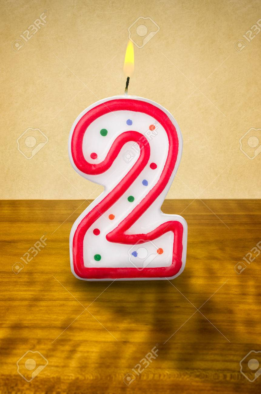 Burning Birthday Candle Number 2 Stock Photo