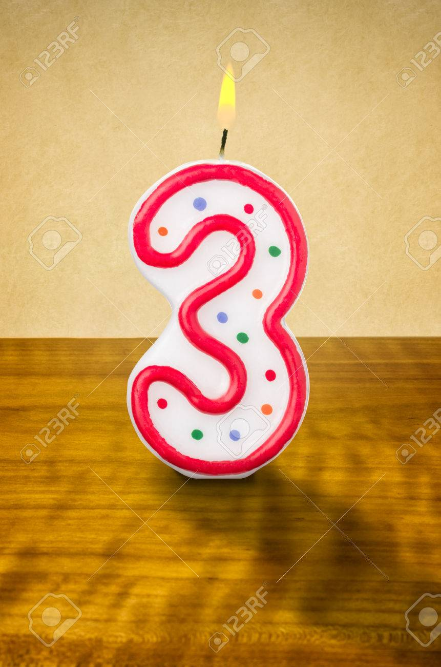 Burning Birthday Candle Number 3 Stock Photo