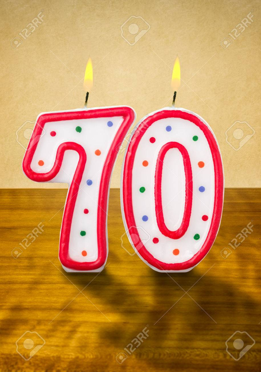 Burning Birthday Candles Number 70 Stock Photo