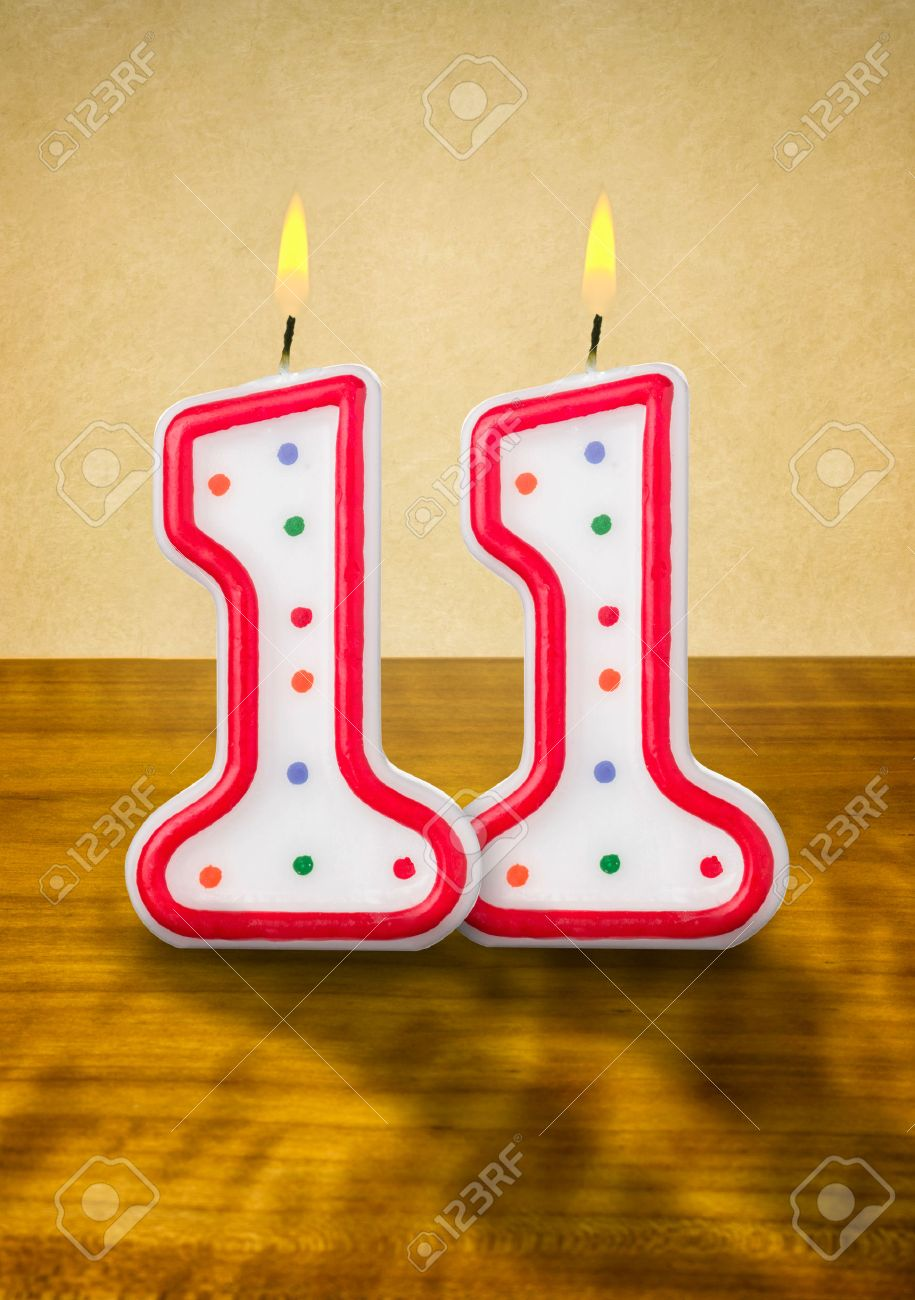 Burning Birthday Candles Number 11 Stock Photo
