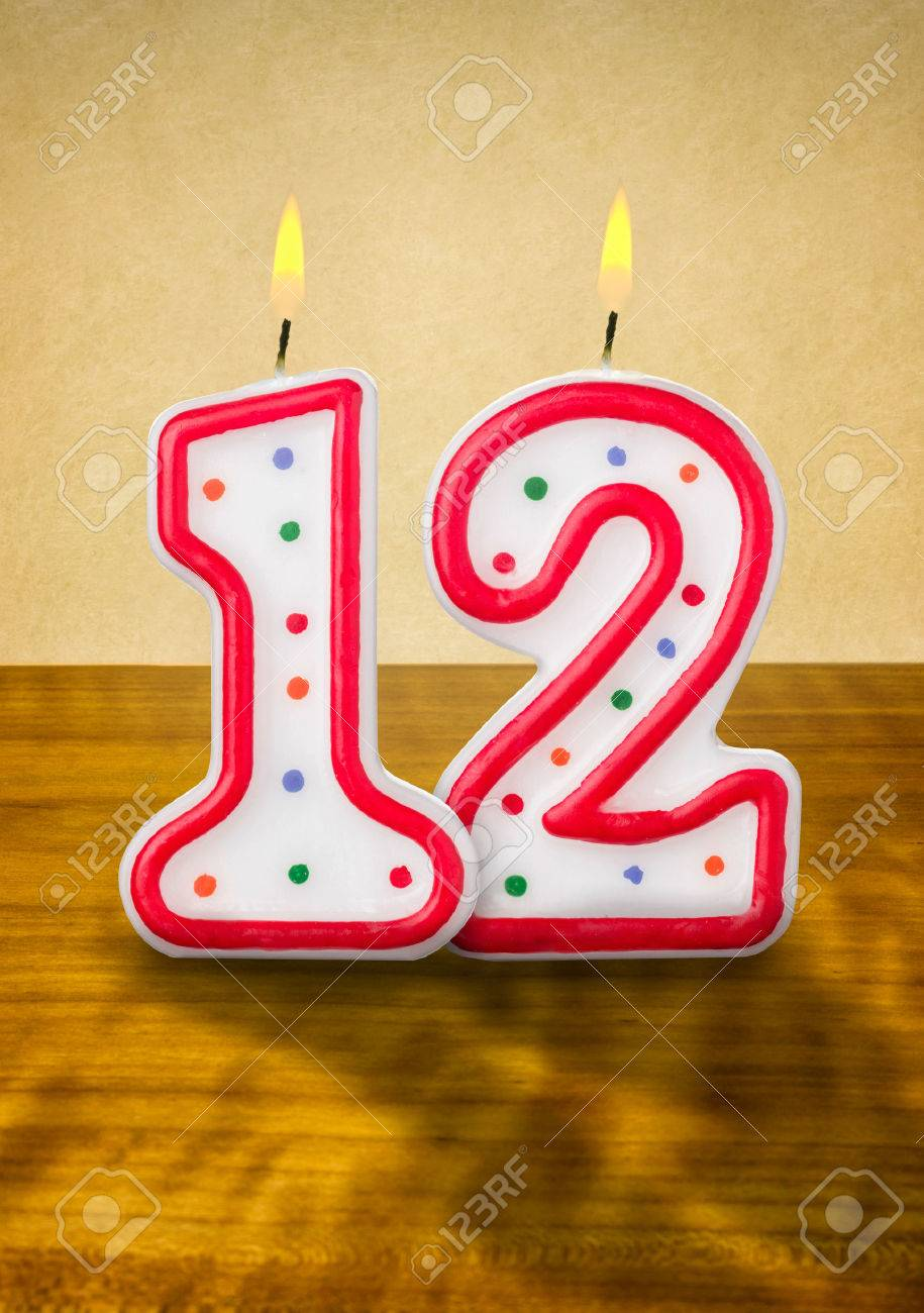 Burning Birthday Candles Number 12 Stock Photo