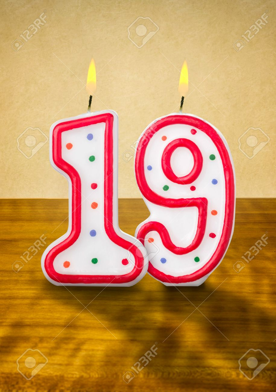 Burning birthday candles number 19 Stock Photo - 26236055