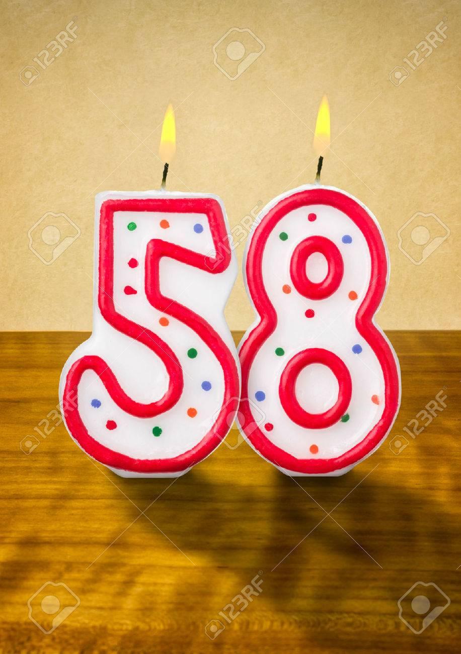 Burning Birthday Candles Number 58 Stock Photo