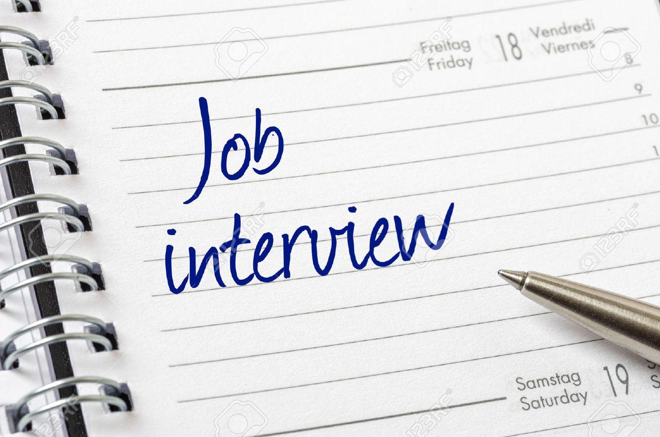 Job interview written on a calendar page - 34215541
