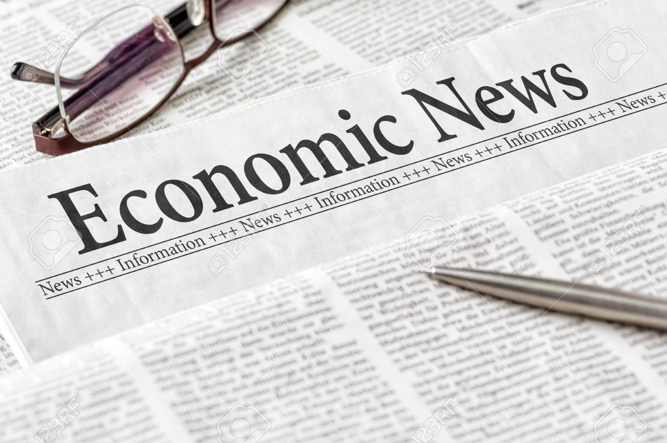 A Newspaper With The Headline Economic News Stock Photo, Picture ...