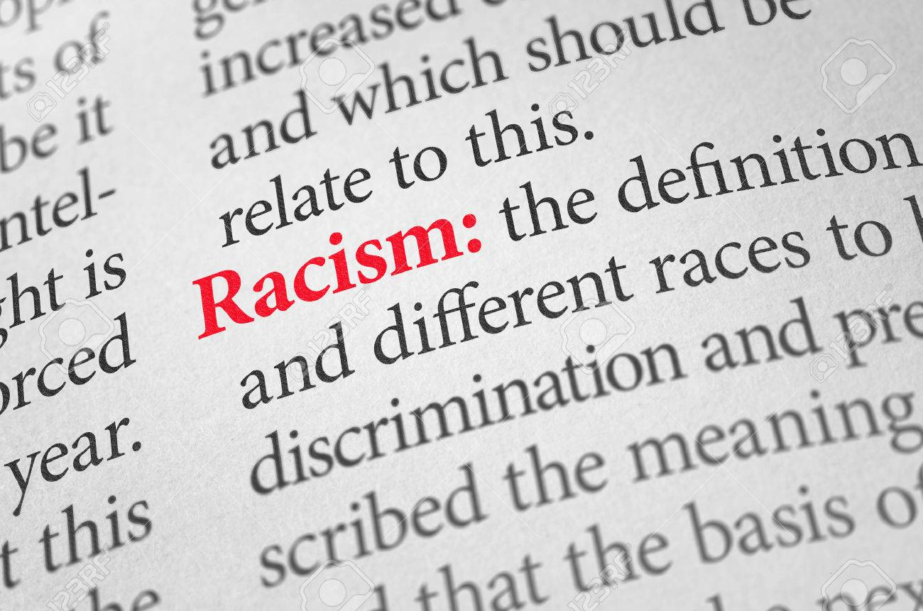 definition of the word racism in a dictionary stock photo, picture