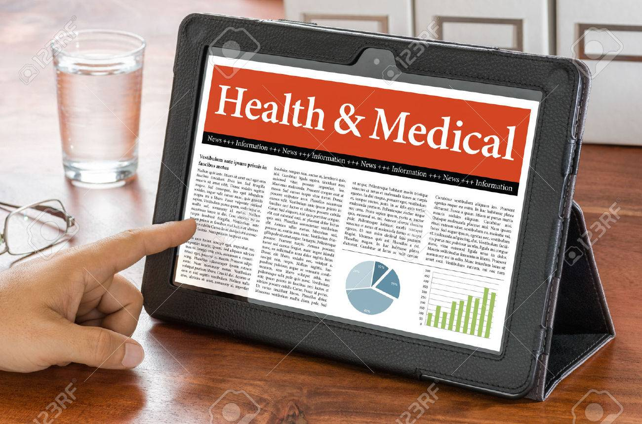 A tablet computer on a desk - Health and Medical - 43211659