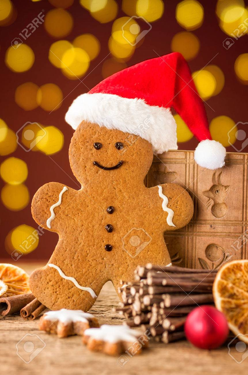 a gingerbread man with a hat and christmas decorations stock photo 47062825