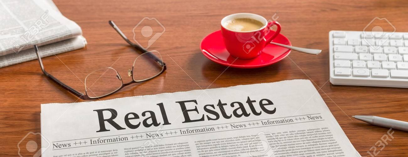 A newspaper on a wooden desk - Real Estate - 59198351