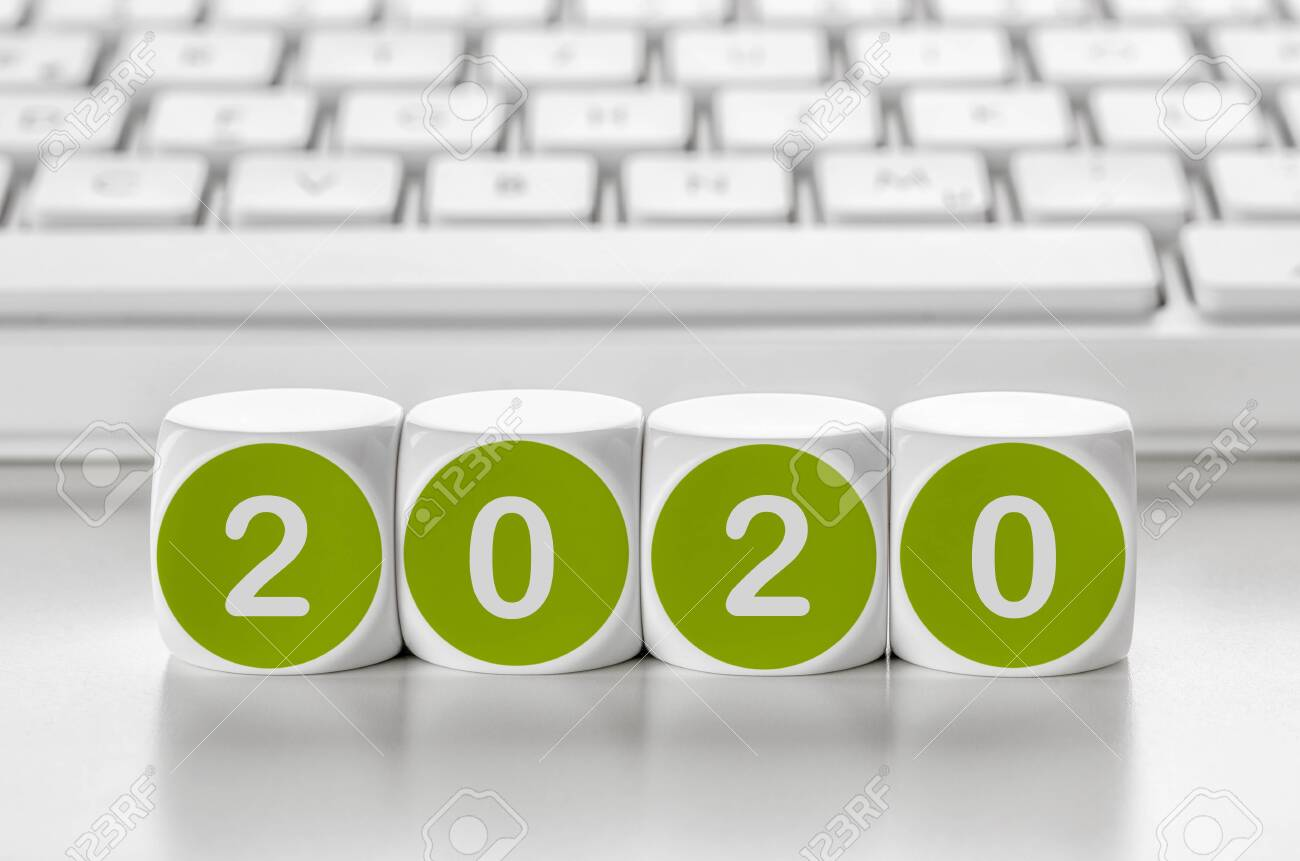 Letter dice in front of a keyboard - 2020 - 134566590