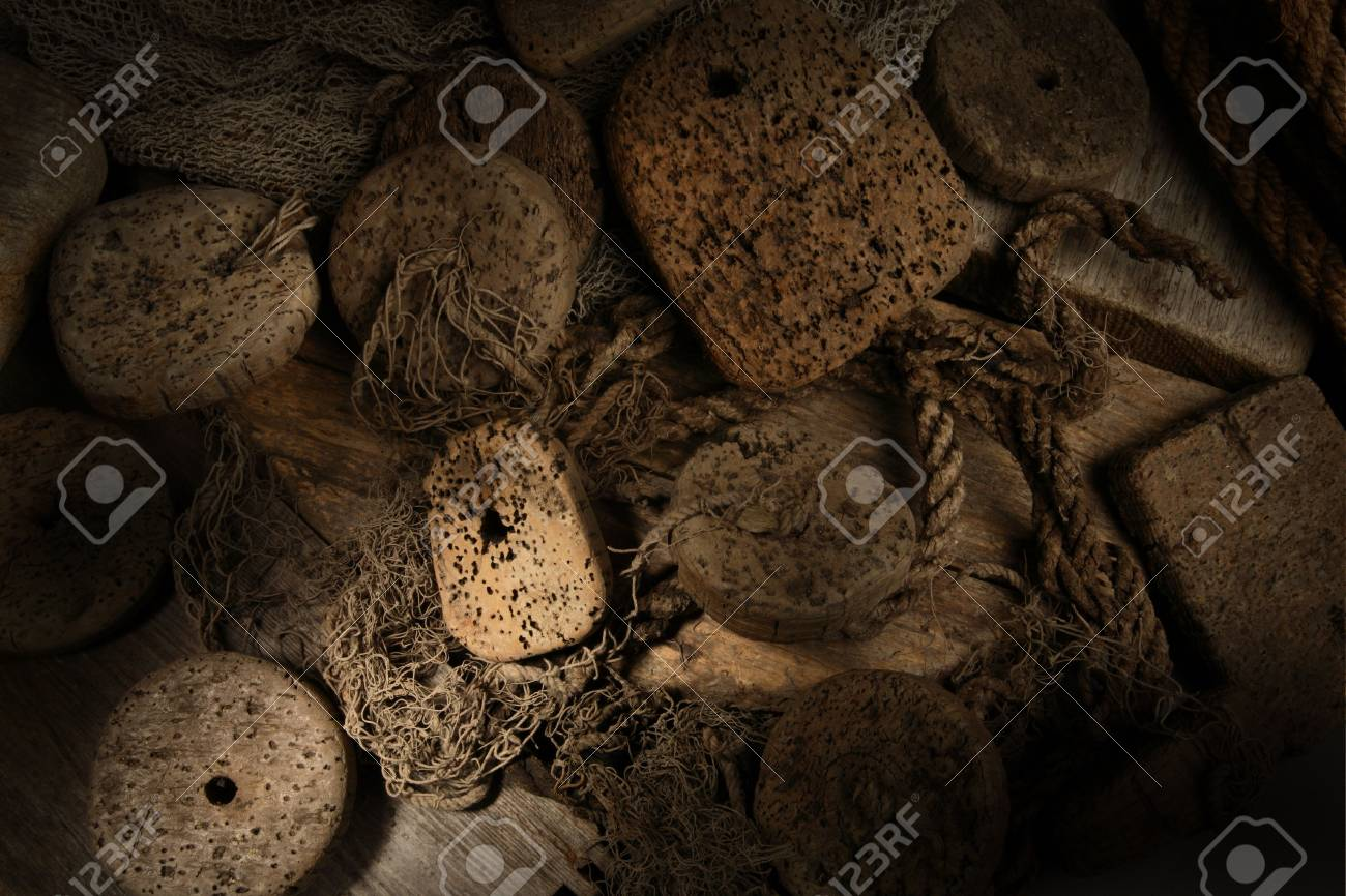 Cork in net with wood background Stock Photo - 8156883