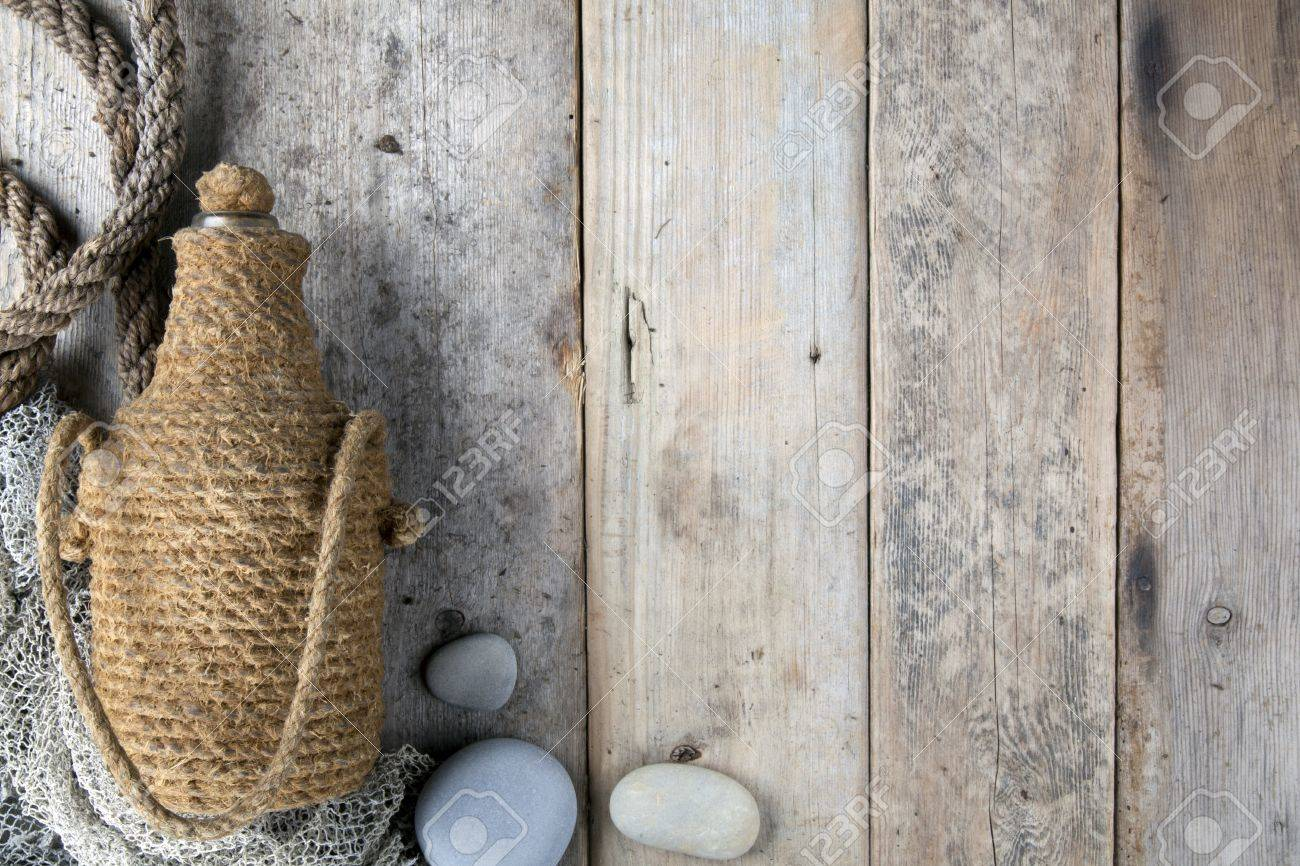 Bottle covered by tar rope with wooden background Stock Photo - 10427265