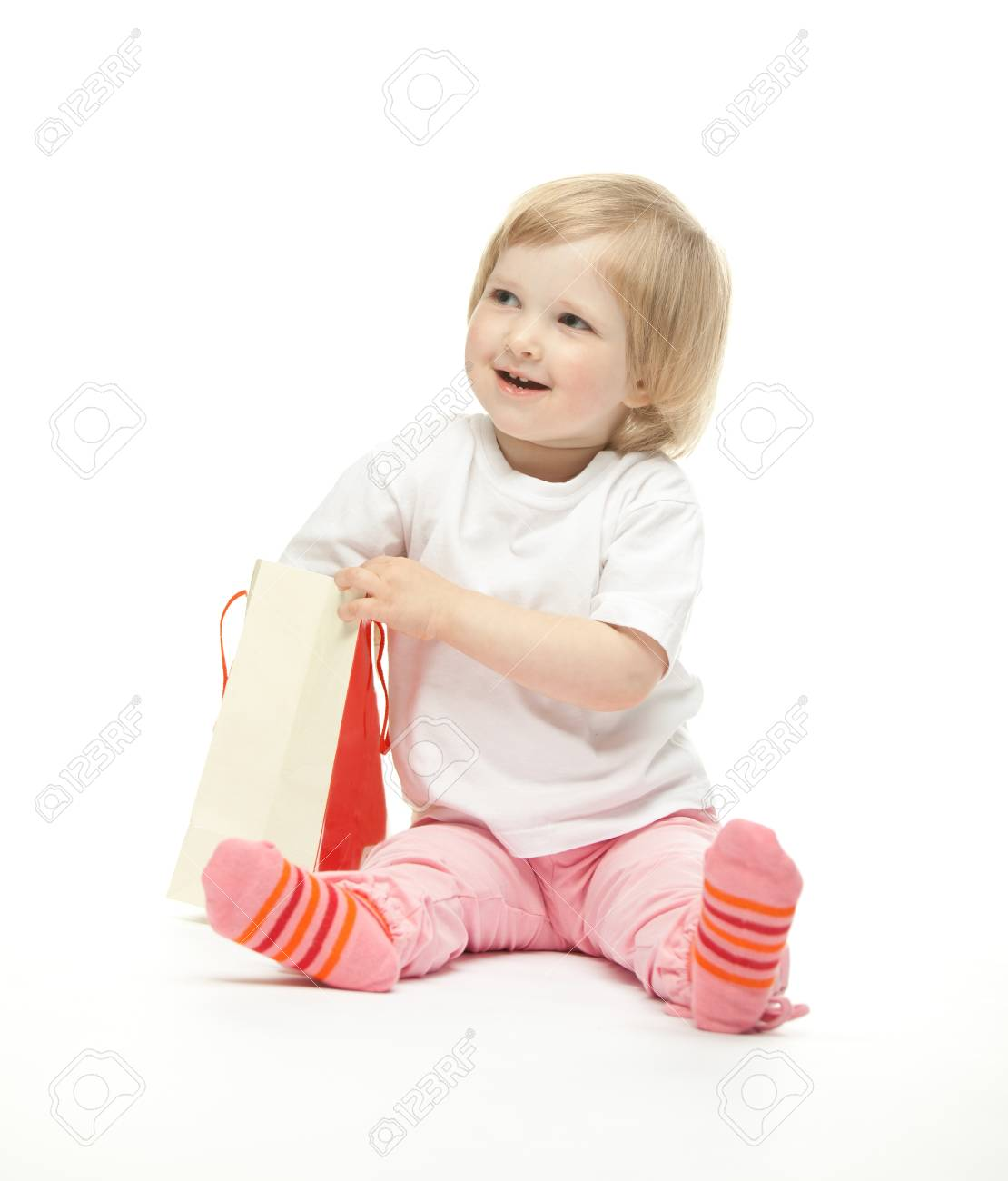 The baby girl finds a present Stock Photo - 11121409