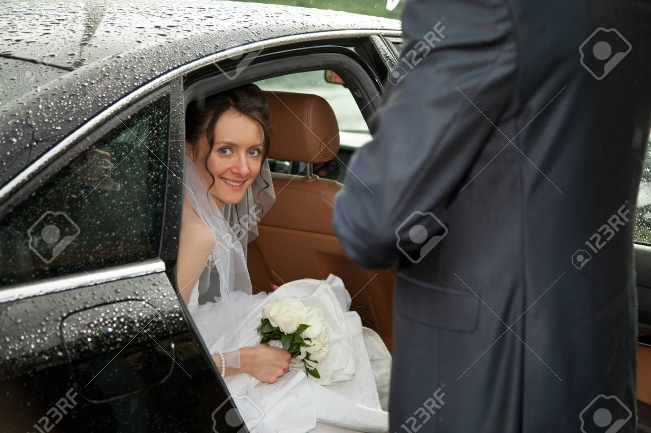 Wedding day: young charming bride looking out of a car Stock Photo - 11174343