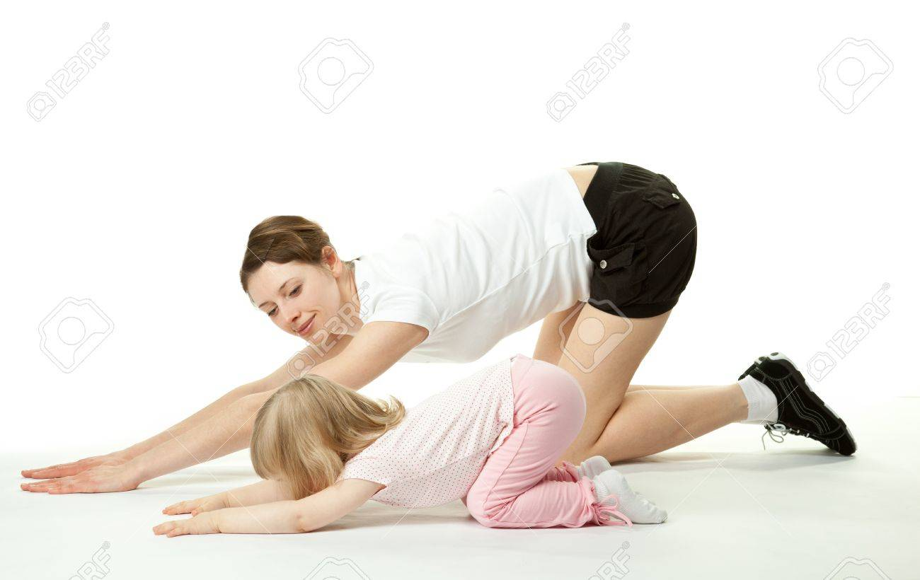 Happy young mother doing sport exercises with her little daughter; white background Stock Photo - 13039119
