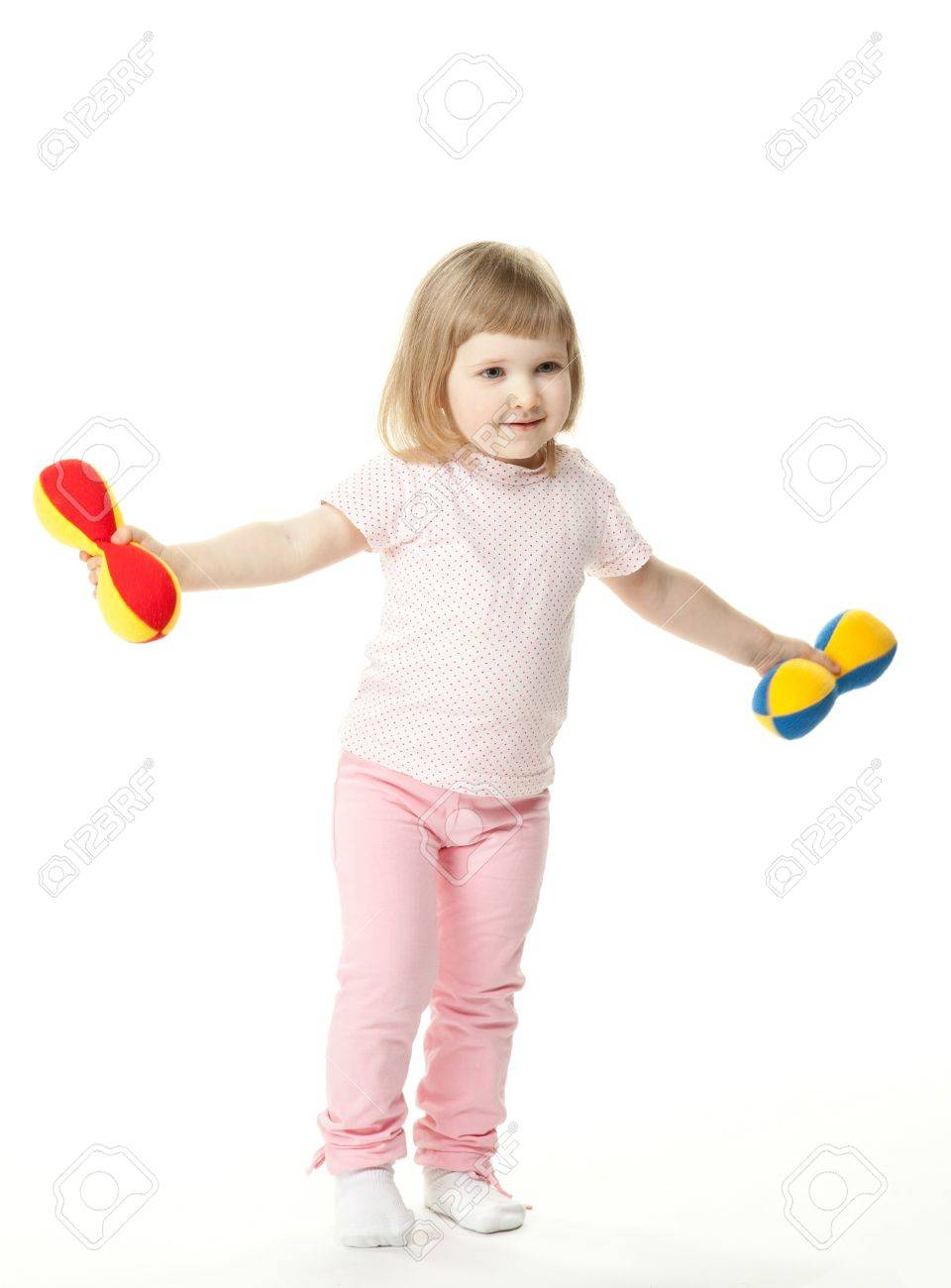 Cute little baby girl doing sport exercises with toy dumbbells; white background Stock Photo - 13147762
