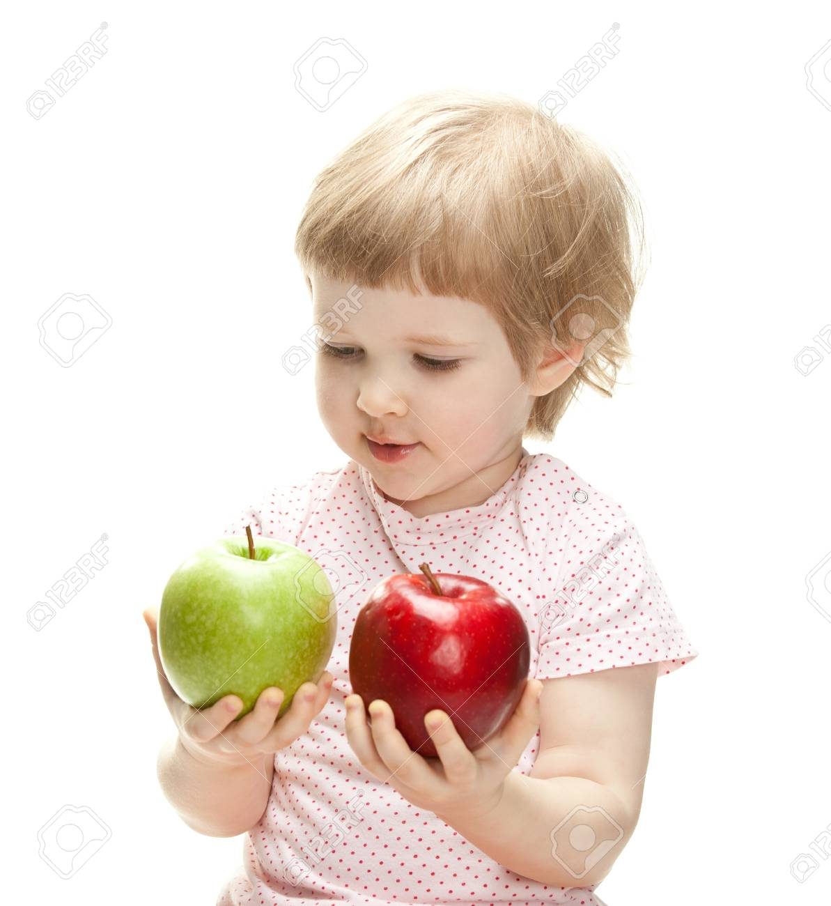 Cute child holding apples looking and them, isolated on white Stock Photo - 13664940