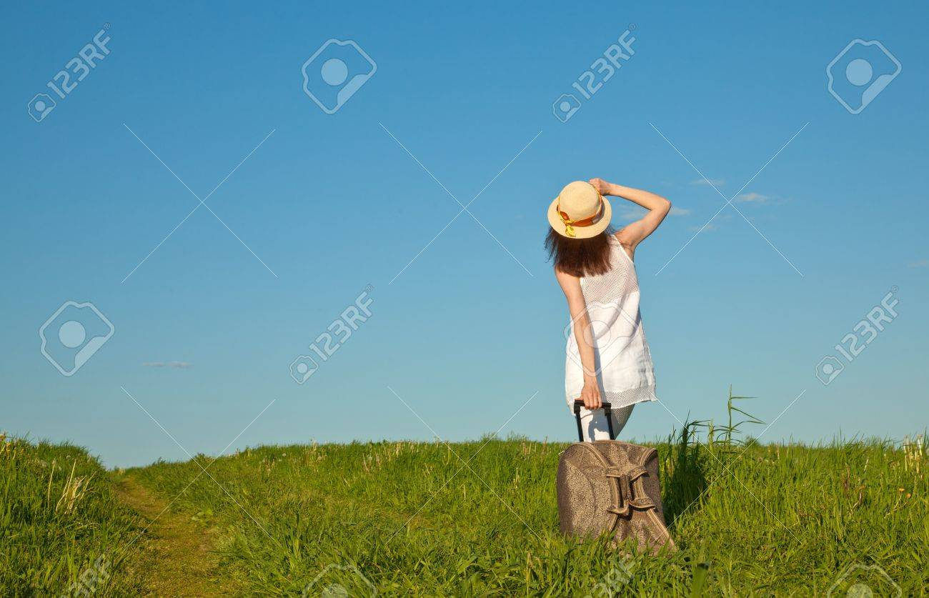 Beautiful young woman travelling with a suitcase, rear view Stock Photo - 13966679