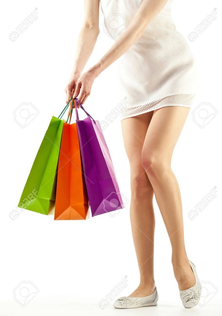 Girl holding multicolored shopping paper bags - closeup shot on white background Stock Photo - 14033053