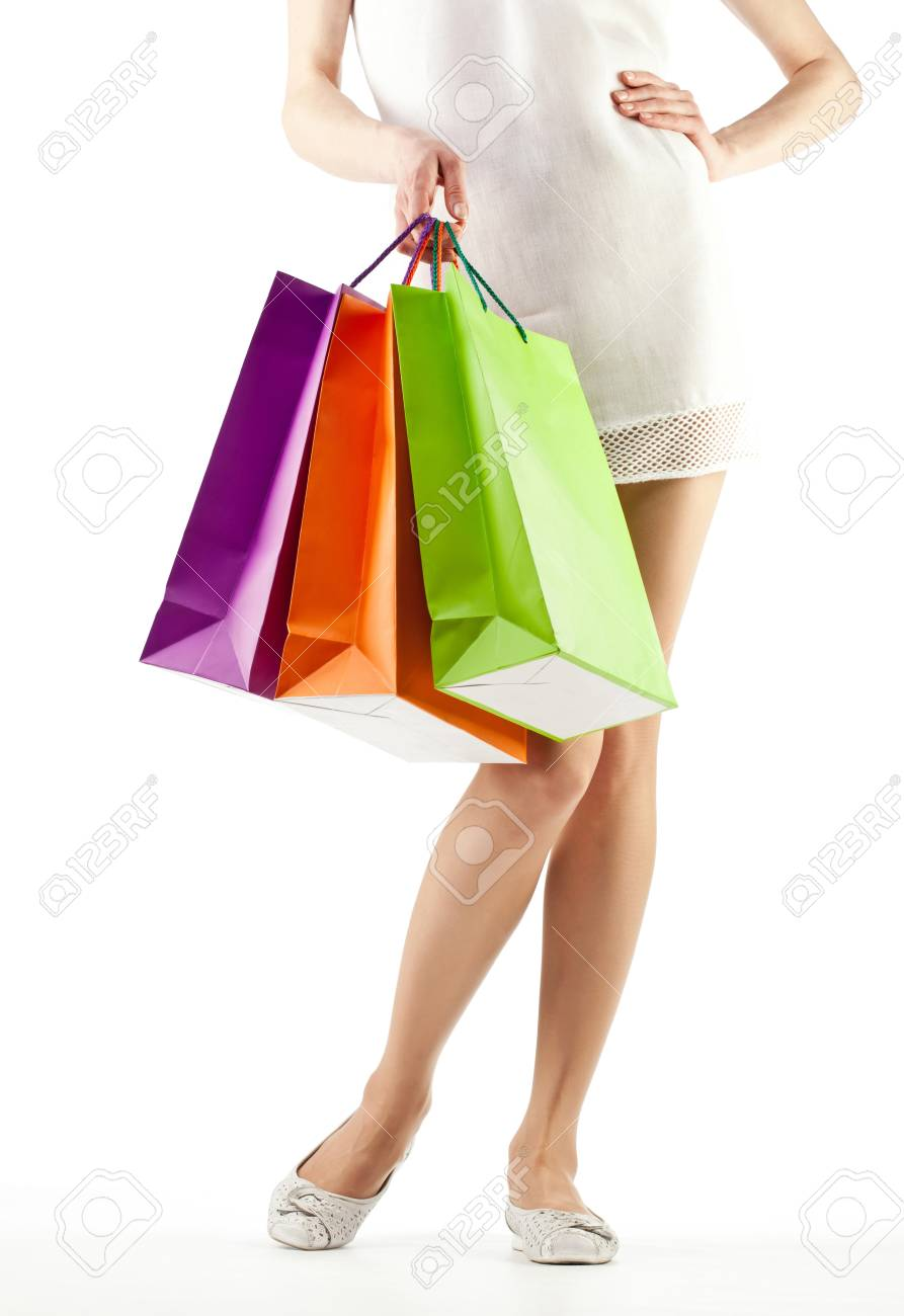 Girl holding multicolored shopping paper bags - closeup shot on white background Stock Photo - 14033063