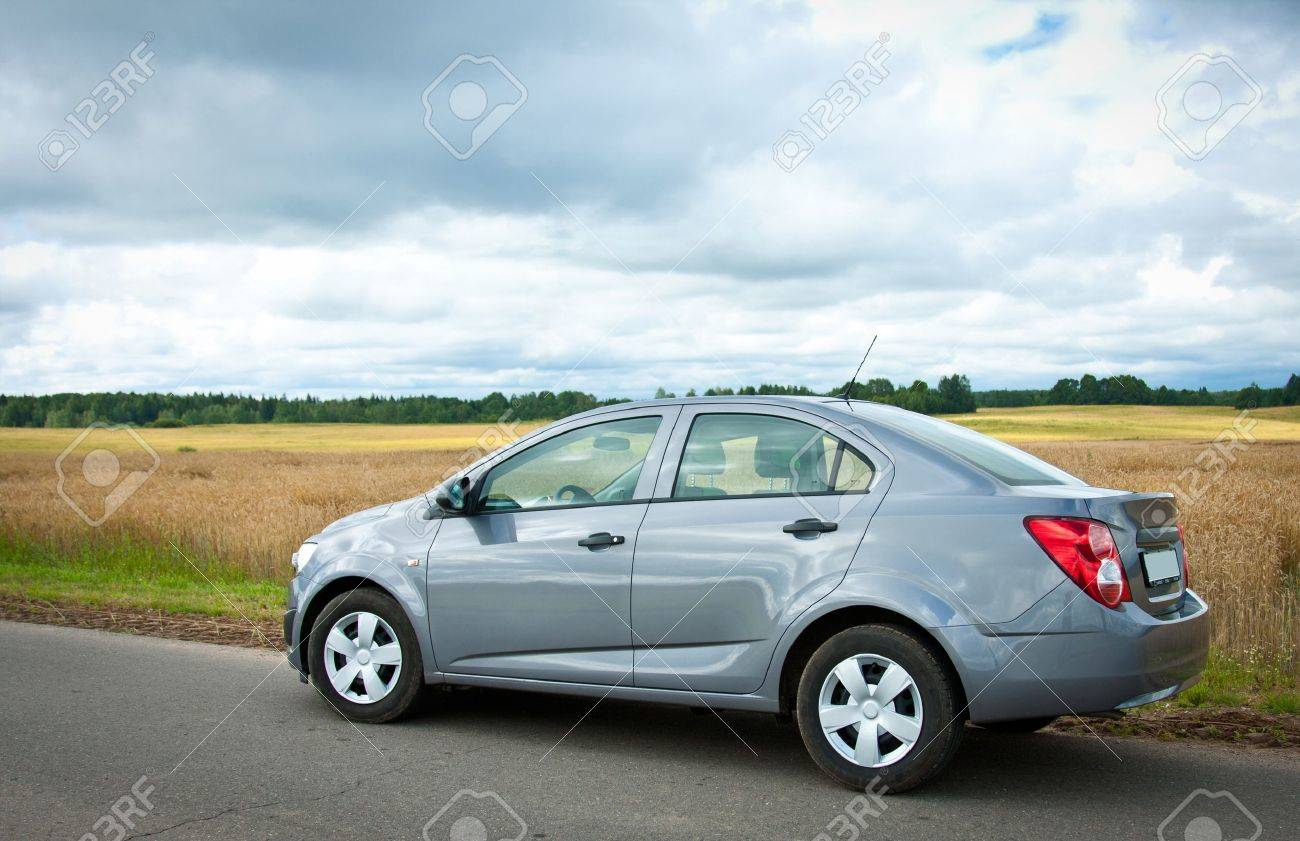 Car on a road against cloudy rural landscape Stock Photo - 14812530