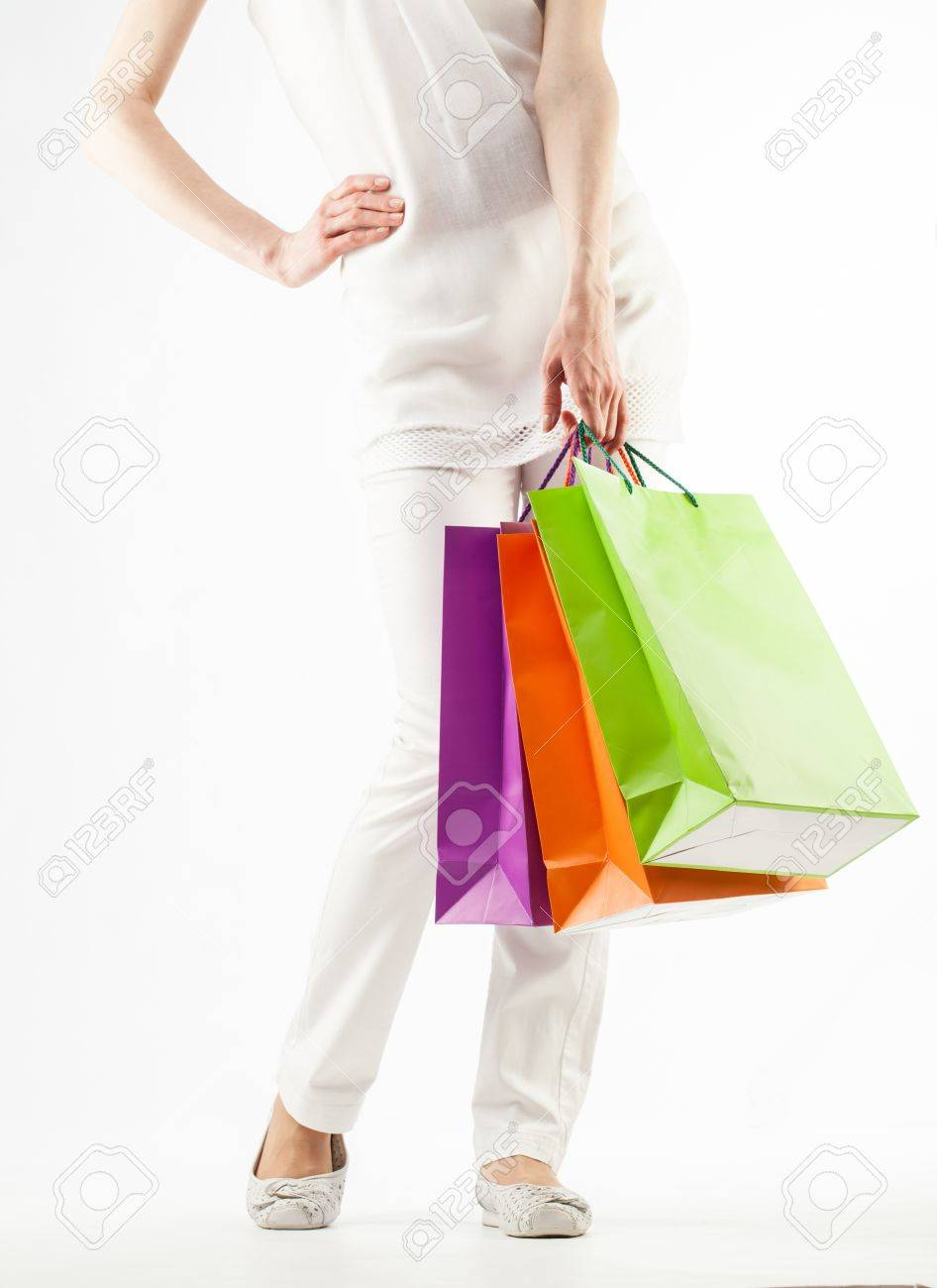 Girl holding multicolored shopping paper bags - closeup shot on white background Stock Photo - 16235116