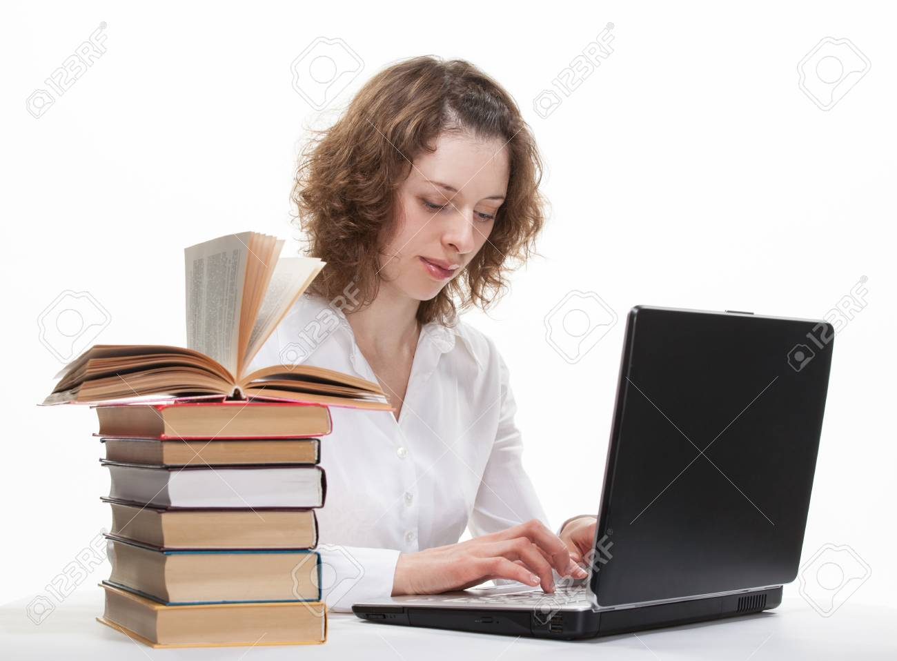 Beautiful smiling young student studying with a notebook Stock Photo - 16483246