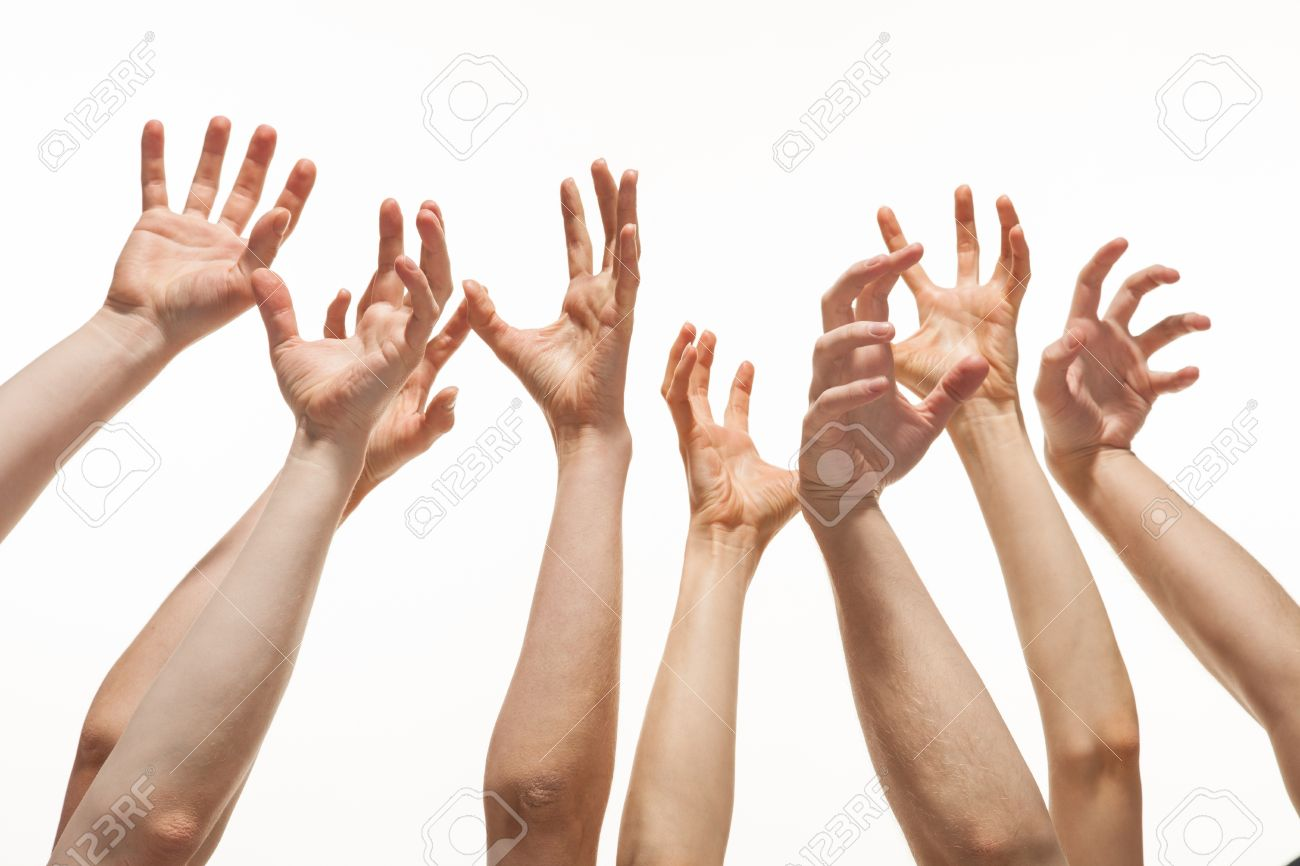 Many hands reaching out up in the air Stock Photo - 18157799