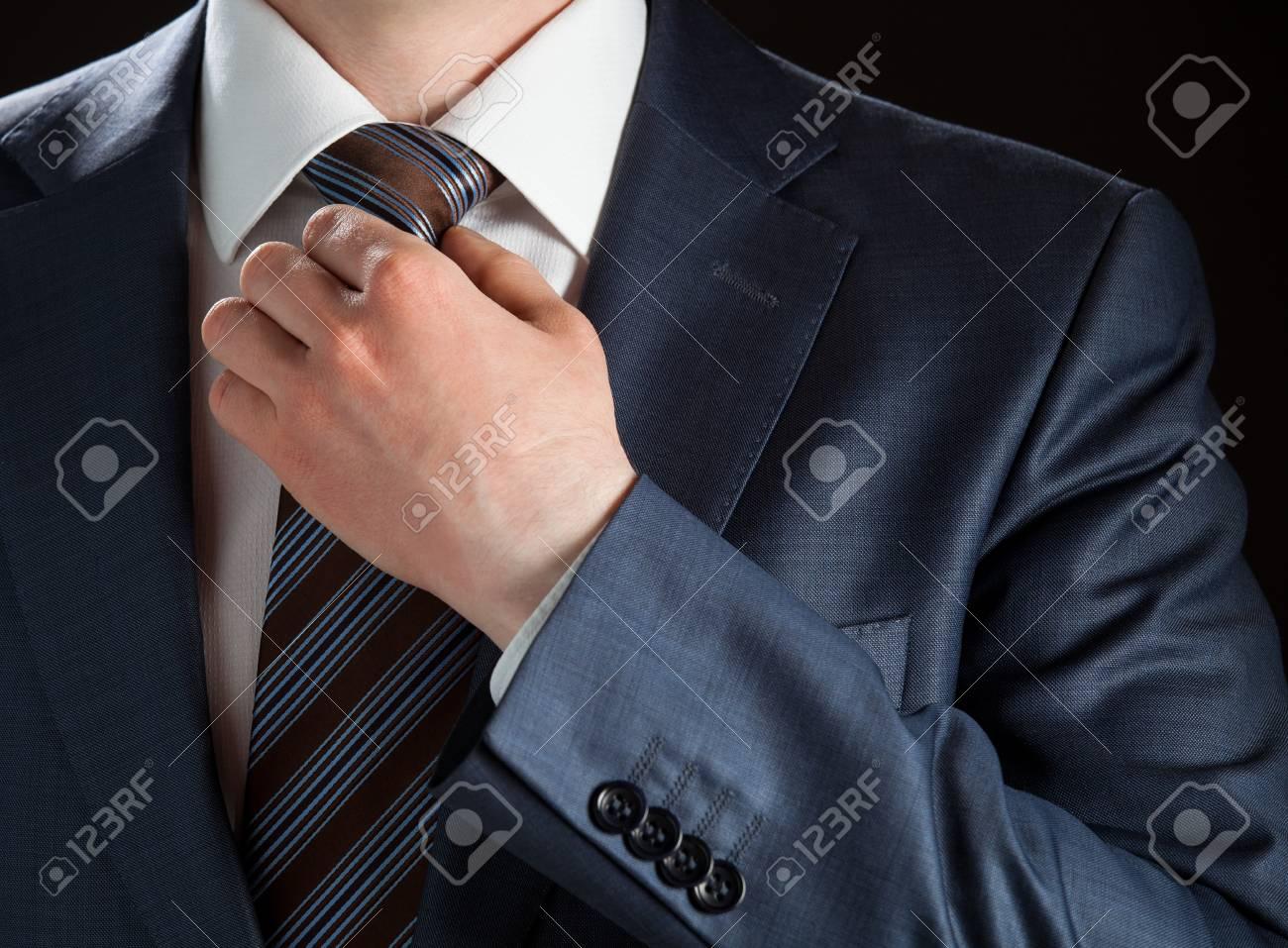 Businessman adjusting his tie - closeup shot - 19310774