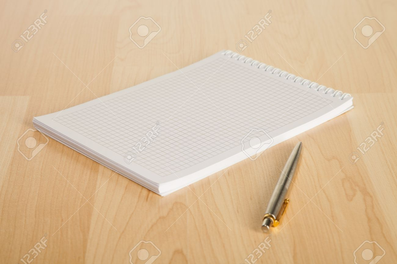Squared Paper Notebook And A Pen On The Table Stock Photo, Picture ...