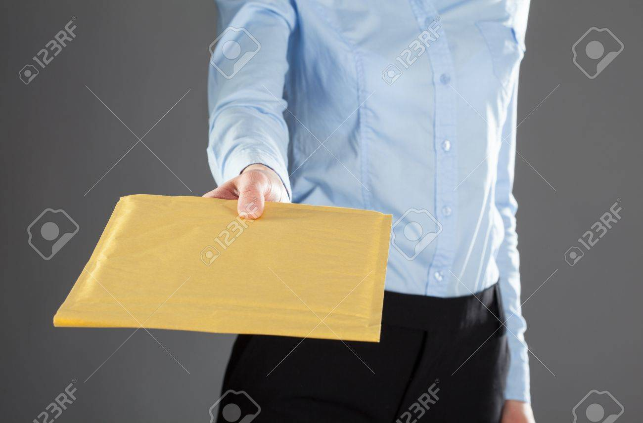 Businesswoman reaching out letter in yellow envelope, closeup shot Stock Photo - 20934996