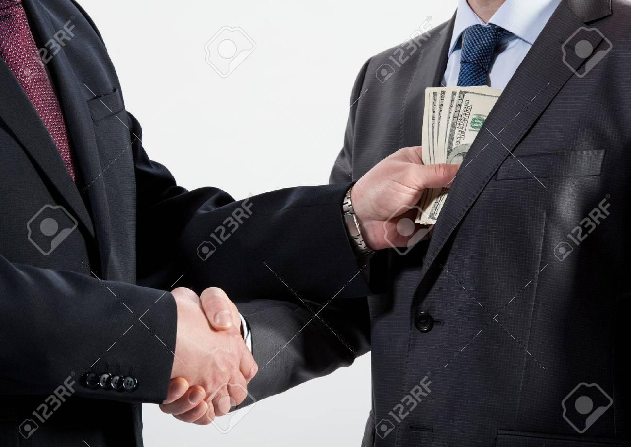Giving a bribe into a pocket - closeup shot - 20935045