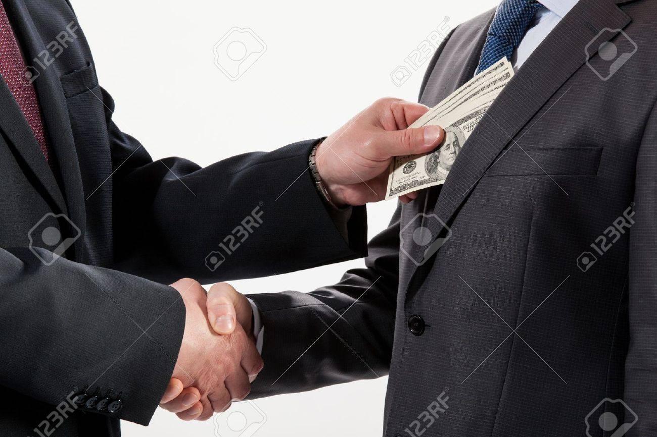 Giving a bribe into a pocket - closeup shot - 20935046