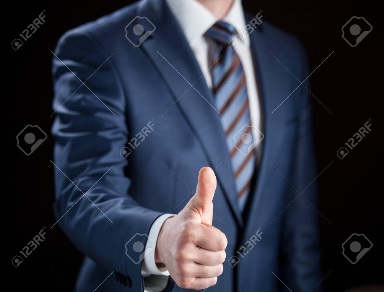 Businessman showing thumbs up - closeup shot - 20935199