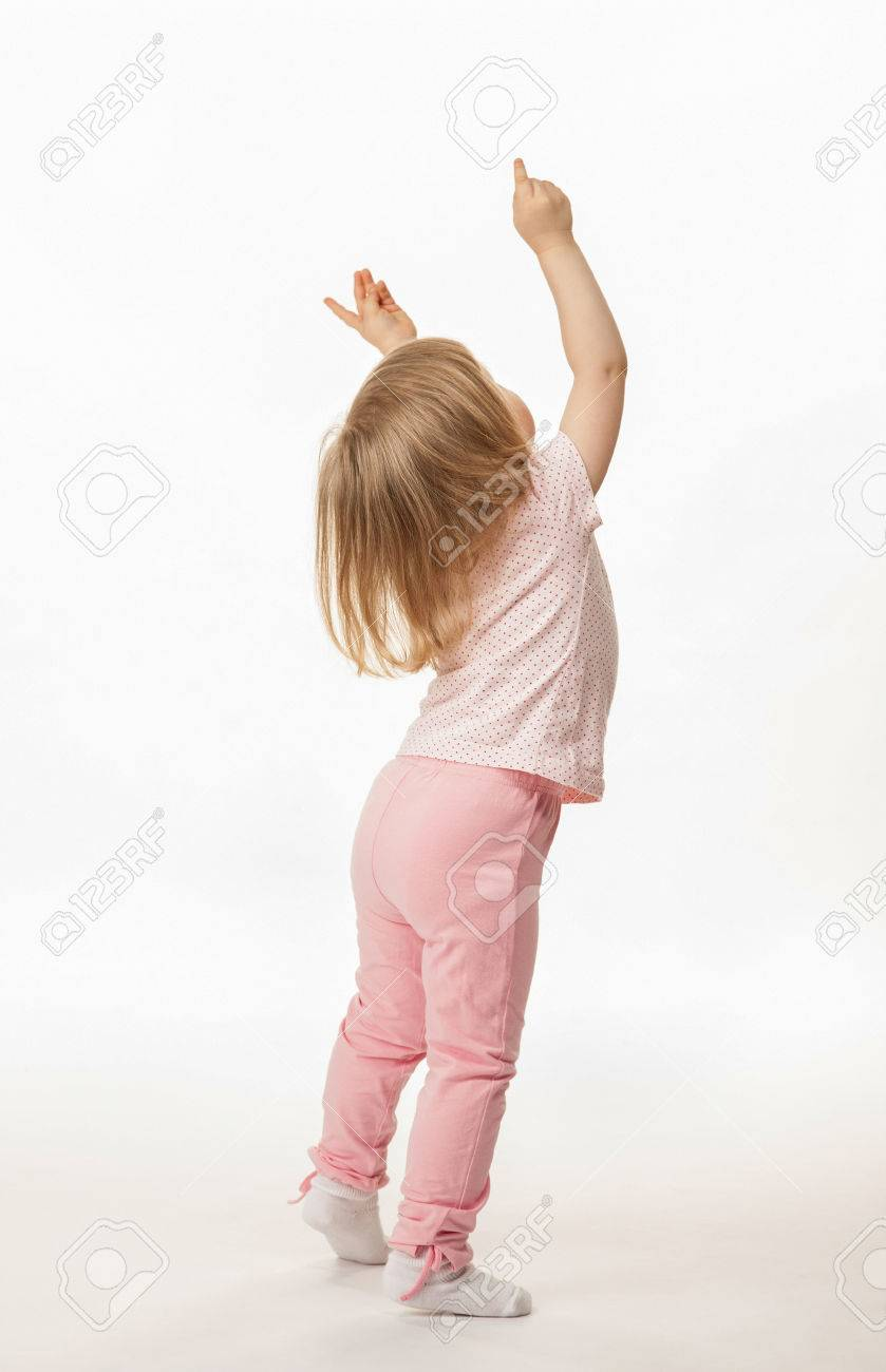 Little baby girl showing something above her, rear view; white background - 22752716