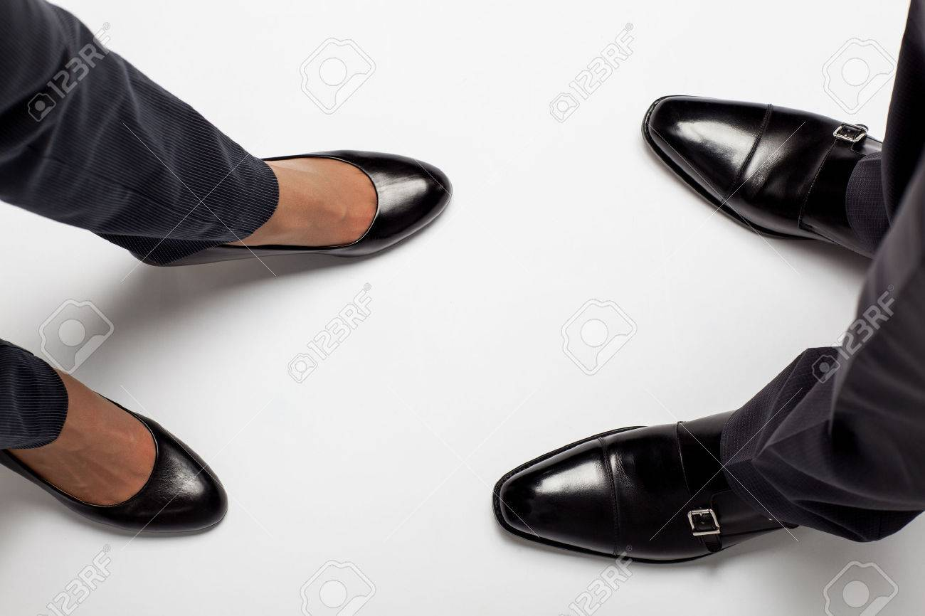 Closeup of businessman's and businesswoman's legs on the floor - 31547720