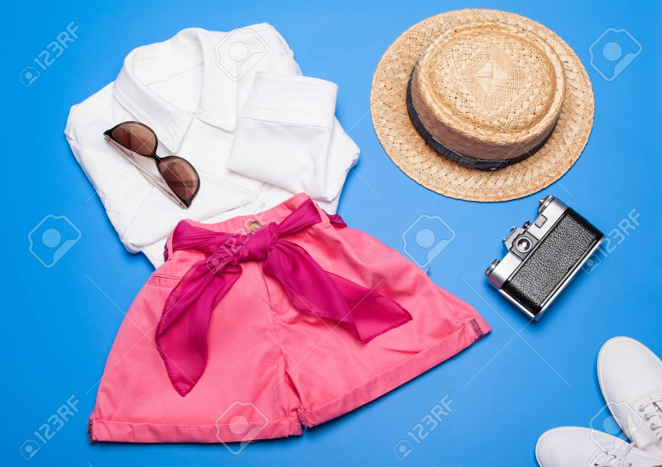 5a8f53004f0 Stock Photo - Summer is coming! Collection of summer woman clothes and  accessories on blue background