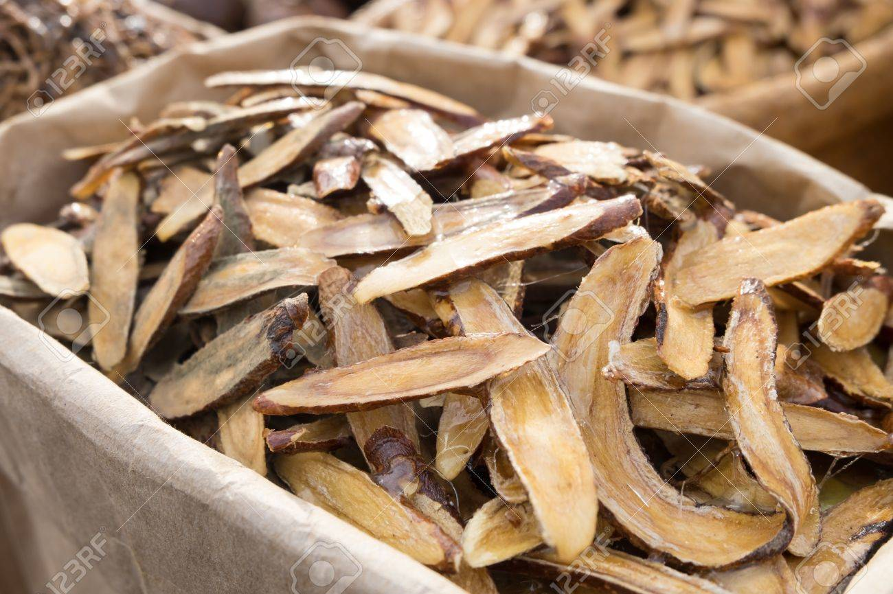 Licorice herbal medicine in wooden chopped and sliced on the table - 45067233