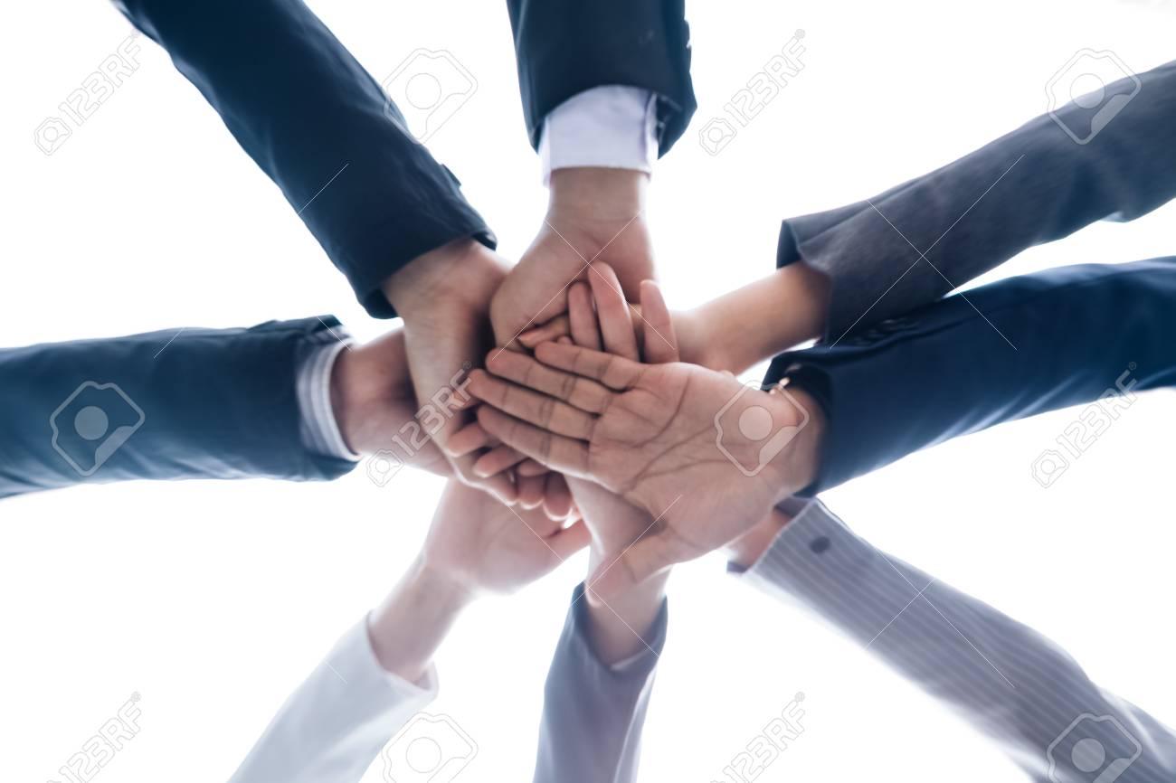 closeup business teamwork bottom view of join hands put together