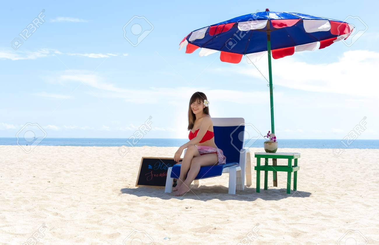 Beautiful Young Woman Sitting On The Beach Chair Under Beach Stock Photo Picture And Royalty Free Image Image 117171913