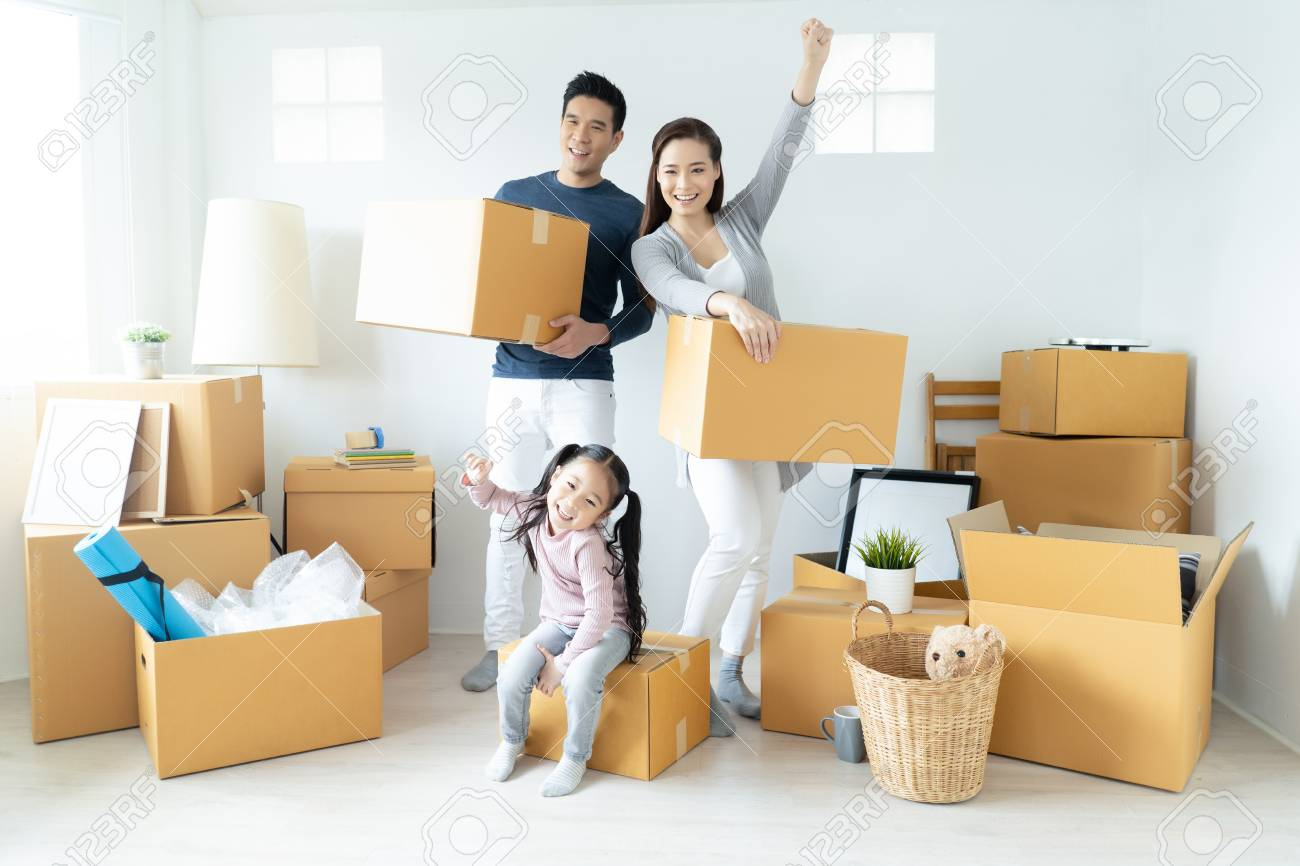 Happy young Asian family moves the boxes to a new home. Moving Concept. - 117172180