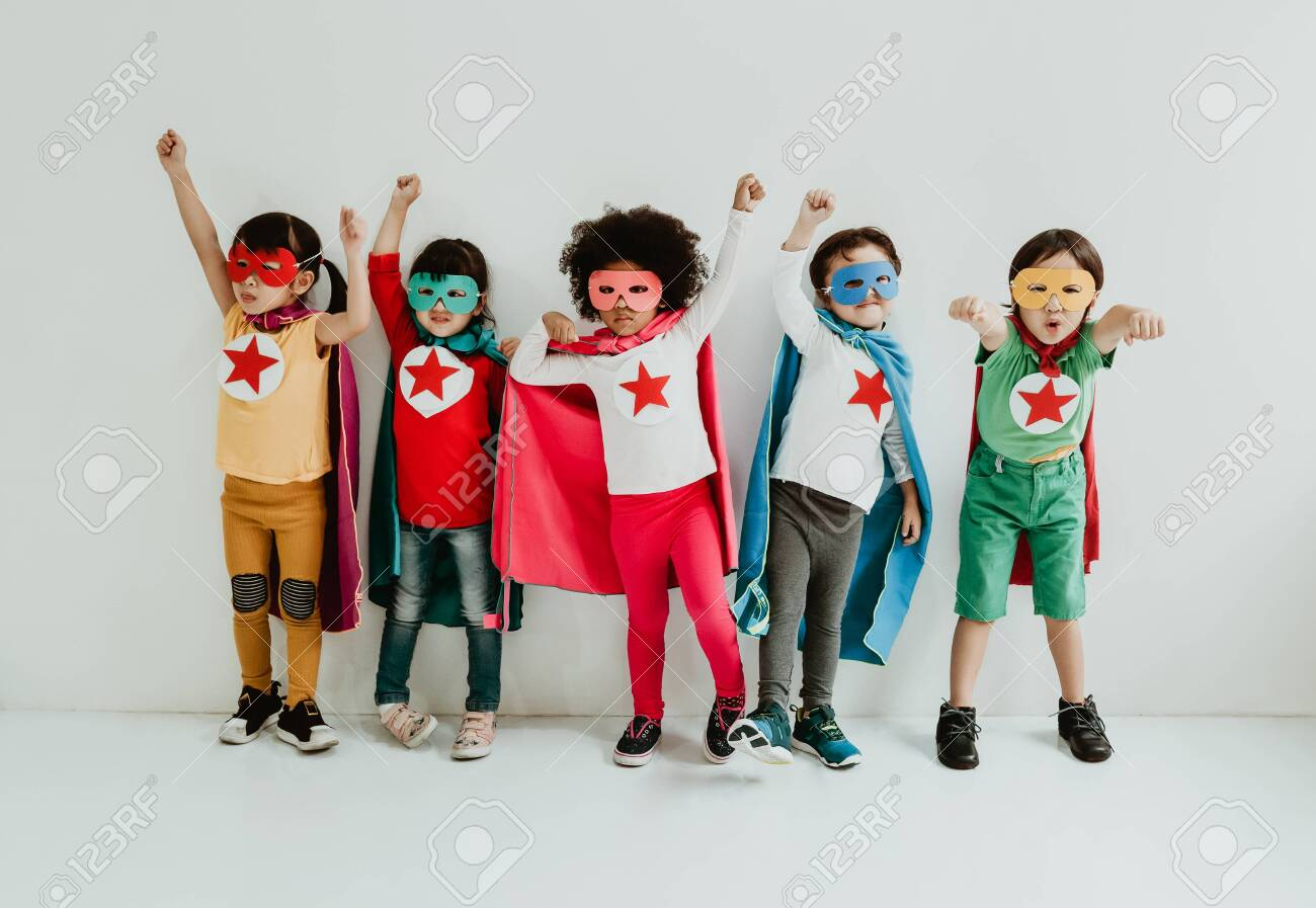 Group of Diverse Children Playing superhero on the white wall background. Superhero concept. Happy Time. - 132043767