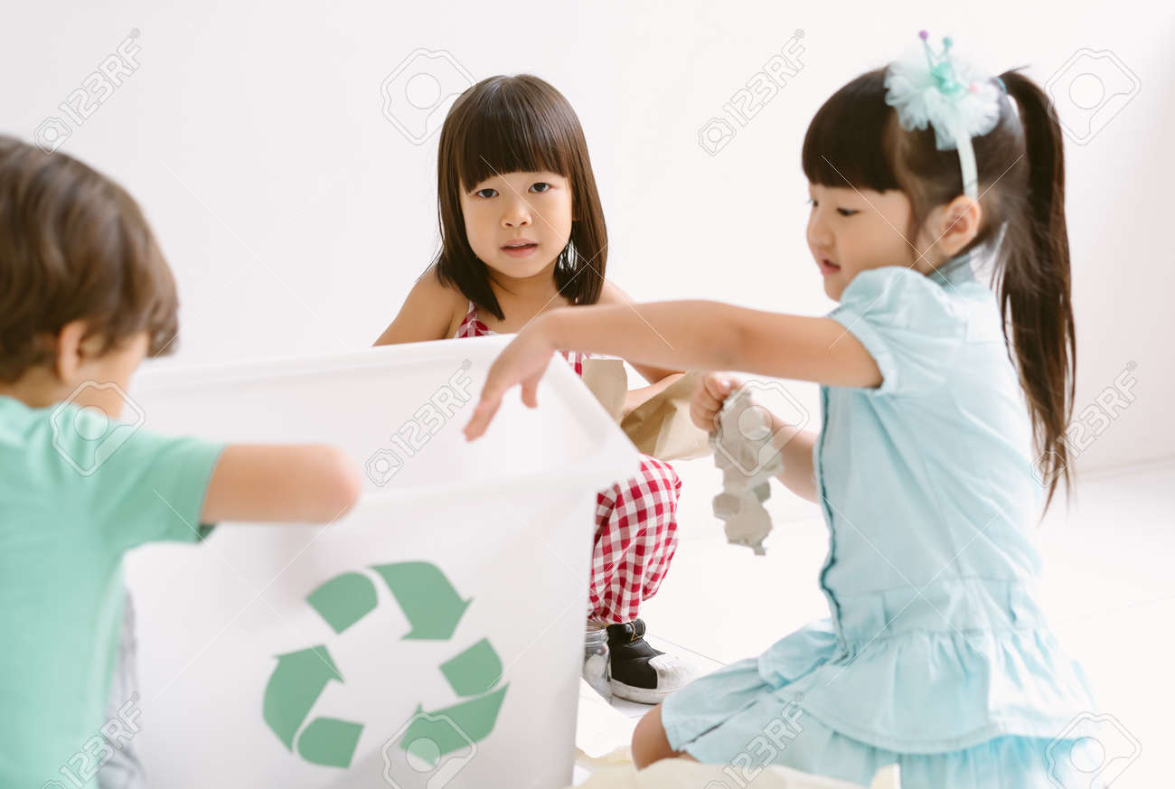 Group of adorable kids school kindergarten learning biology recycle environment, sort waste in classroom at kindergarten. Education, Recycling and Ecology protection concept. - 173130742