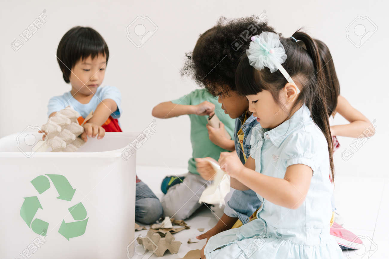 Diversity Children learning biology recycle environment, waste separation in classroom at kindergarten. Education, Recycling and Ecology protection concept. - 173415236