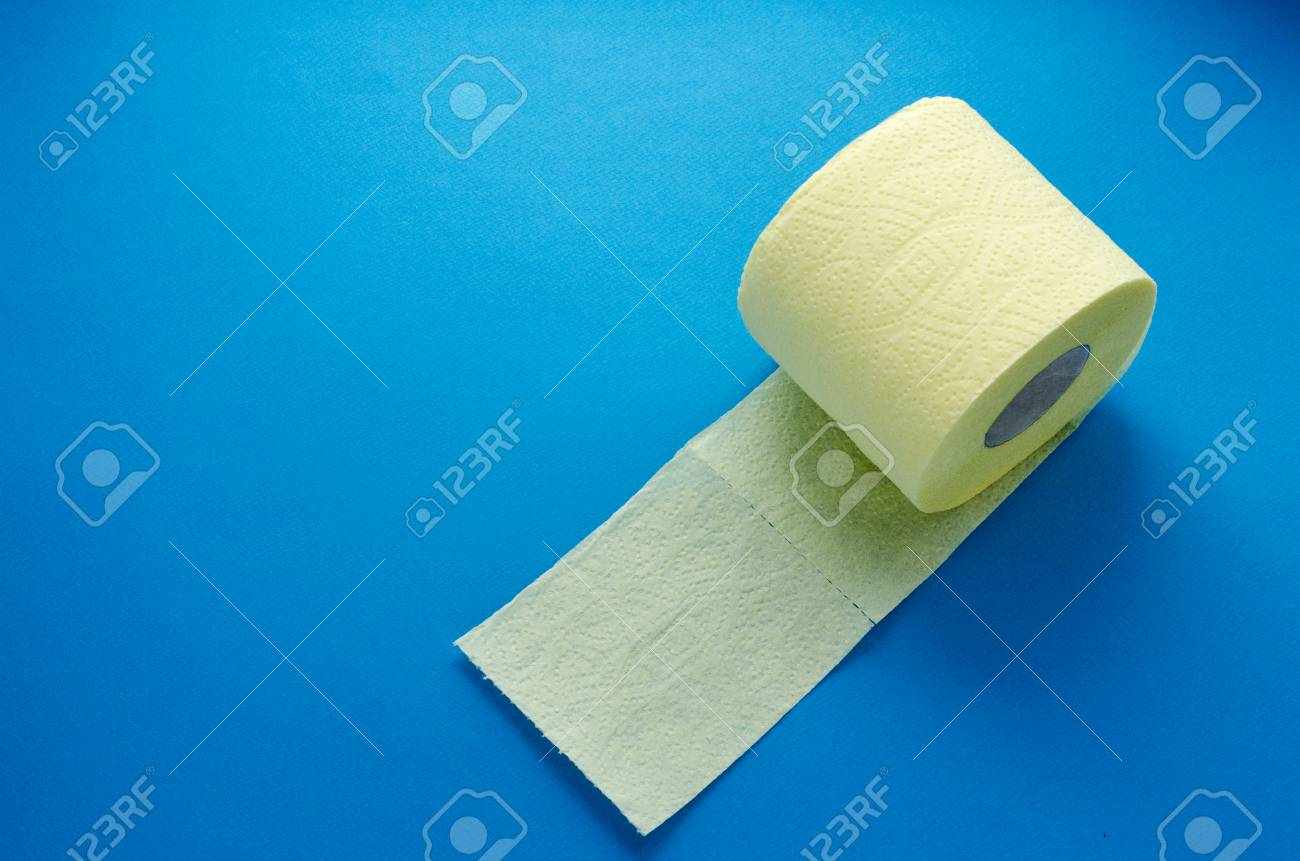 yellow toilet paper roll on blue backgroung