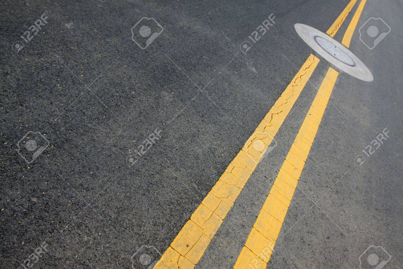 yellow double solid line on the road Stock Photo - 19224104