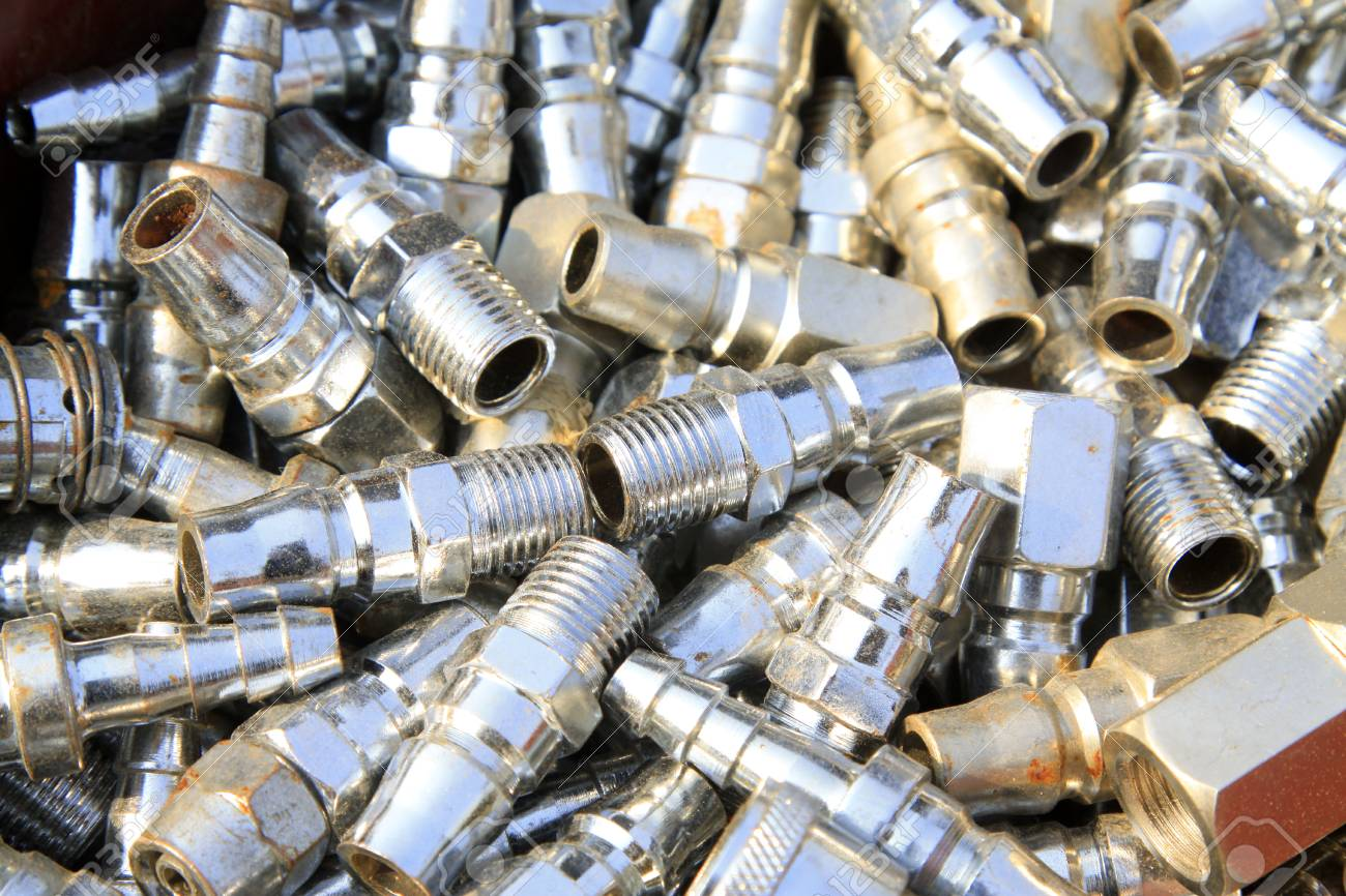 Threaded stainless steel pipe fittings piling up in together