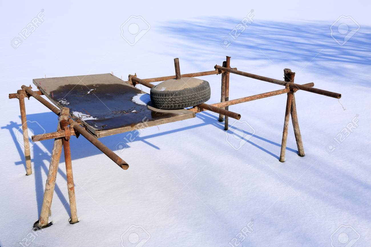 wooden support on a pond after a snow, closeup of photo Stock Photo - 27365328