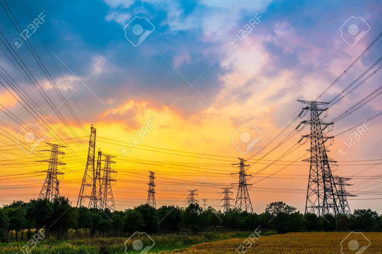 Industrial high voltage electricity tower and beautiful nature landscape at summer sunset - 142519407